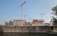 Building works with several cranes at Kupfergraben and Schlossplatz, with the Fernsehturm or TV Tower and the Berliner Dom or Cathedral in the distance, Berlin, Germany. Picture by Manuel Cohen