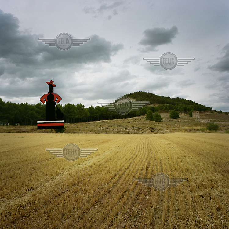 The iconic Tio Pepe sherry advertisement standing in the middle of a field of wheat.