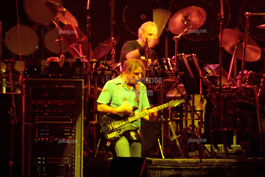 "Bob Weir and Bill Kreutzmann performing with The Grateful Dead Live at The Hampton Coliseum on 8 October 1989. One of the Eleven images included in the CD boxed set release, ""Formerly The Warlocks"". Can be purchased individually or as part of a special limited set of all 11 in the package printed by the photographer. Choose in Cart."