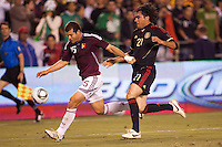 Alejandro Moreno (15) forward for Venezuela attempts to move past Mexico national team defender Edgar Duenas (21). The national teams of Mexico and Venezuela played to a 1-1 draw in an International friendly match at  Qualcomm stadium in San Diego, California on  March 29, 2011...