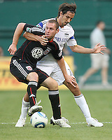 Kurt Morsink #6 of D.C.United is held by Santiago Hirsig #10 of the Kansas City Wizards during an MLS match at RFK Stadium on May 5 2010, in Washington DC. United won 2-1