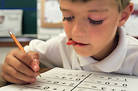 A primary grade student works on his math homework at Bryte Elementary. This West Sacramento school outscores most schools in the Washington Unified School District despite its high concentration of poverty. August 1997