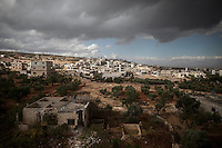 In this Thursday, Oct. 03, 2013 photo, shows Kafr Lata, a ghost village in a top of a mountain subdued under heavy shelling and bormbardments due the fighting between opposition fighters and government forces in the Idlib province countryside of Syria. (AP Photo)
