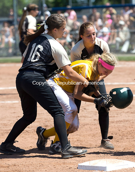 West Haven, CT- 13 June 2015-061315CM13-   Holy Cross' Sydney McIldowie is helped up by Thomaston's Alexa Milius #16 and Nina Barone, right, after sliding hard into third base during the Class S state softball final in West Haven on Saturday.  Christopher Massa Republican-American