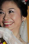 Taiwanese Wedding -- Bride smiling.