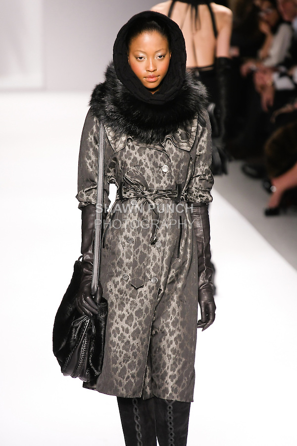 Nyasha Matonhodze walks runway in an outfit from the Elie Tahari Fall 2011 collection, during Mercedes-Benz Fashion Week Fall 2011.