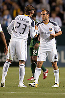 David Beckham (23) congratulates Landon Donovan (10) as Donovan prepares to exit the pitch late in the match. The LA Galaxy defeated the Portland Timbers 3-0 at Home Depot Center stadium in Carson, California on  April  23, 2011....