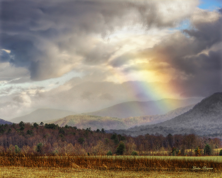 "A colorful ""sun dog"" provides a peaceful contrast to angry storm clouds over Cades Cove in this HDR image."
