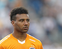 Houston Dynamo midfielder Giles Barnes (23). In a Major League Soccer (MLS) match, Houston Dynamo (orange) defeated the New England Revolution (blue), 2-1, at Gillette Stadium on July 13, 2013.