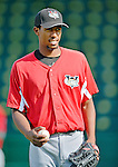 19 July 2012: Tri-City ValleyCats pitcher Juan Minaya warms up prior to a game against the Vermont Lake Monsters at Centennial Field in Burlington, Vermont. The ValleyCats defeated the Lake Monsters 6-3 in NY Penn League action. Mandatory Credit: Ed Wolfstein Photo