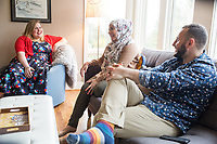 "SEATTLE, WA-APRIL 17, 2017: Amanda Saab, center, along with her husband Hussein Saab, joke with Stefanie Fox, left, before they co-host a ""dinner with your Muslim neighbor"" at the home of Stefanie and Nason (cq) Fox in Seattle, WA on April 17th 2017. (Photo by Meryl Schenker/For The Washington Post)"