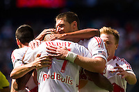 Kenny Cooper (33) of the New York Red Bulls celebrates scoring with teammates . The New York Red Bulls defeated the Philadelphia Union 2-0 during a Major League Soccer (MLS) match at Red Bull Arena in Harrison, NJ, on July 21, 2012.