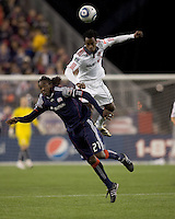 New England Revolution midfielder Shalrie Joseph (21) and Toronto FC midfielder Amadou Sanyang (22) battle for head ball. The New England Revolution defeated Toronto FC, 4-1, at Gillette Stadium on April 10, 2010.