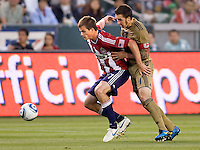 CD Chivas USA forward Justin Braun (17) battles for control of the ball against Philadelphia Union defender Danny Califf (4). The Philadelphia Union and CD Chivas USA played to 1-1 draw at Home Depot Center stadium in Carson, California on Saturday evening July 3, 2010..