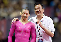 Kyla Ross's coach Howard Liang congratulates Kyla Ross after competing on uneven bars during the 2012 US Olympic Trials competition at HP Pavilion in San Jose, California on June 29th, 2012.