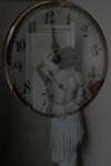 A woman behind a clock