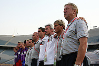 Germany's Head Coach Horst Hrubesch and his coaching staff stands on the field before the match against Brazil during the FIFA Under 20 World Cup Quarter-final match at the Cairo International Stadium in Cairo, Egypt, on October 10, 2009. Germany lost 2-1 in overtime play.