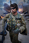 Australian peacekeeprs provide security for East Timorese firefighters, the Bombeiros, attempt to put out a major fire lit by fueding gangs in Calico, near the Old Market area, as continual violence, looting and arson disrupt Dili.  Acts of arson across Dili have become a continual occurence. .07/06/06