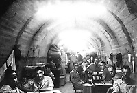 During the siege of Corregidor, P.I., the Finance Office, U.S. Army, Manila, shared lateral No. 12 of Melinta Tunnel with the Signal Corps. Members of the Finance Office staff appear in the foreground.  Ca. March/April 1942.  Maj. Paul Wing. (Army)  <br /> Exact Date Shot Unknown<br /> NARA FILE #:  111-SC-249636<br /> WAR &amp; CONFLICT BOOK #:  1141