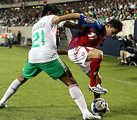 Mexico's Juan Carlos Valenzuela (21) pressures Costa Rica's Pablo Herrera (17).  Mexico defeated Costa Rica 2-1 on penalty kicks in the semifinals of the Gold Cup at Soldier Field in Chicago, IL on July 23, 2009.