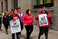 The march made its way through downtown Chicago, enduring occasional rain showers that may have dampened the participants clothing, but certainly not their spirits.