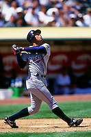 OAKLAND, CA - Roberto Alomar of the Cleveland Indians bats during a game against the Oakland Athletics at the Oakland Coliseum in Oakland, California in 1998. Photo by Brad Mangin