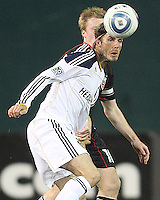 Dax McCarty (10) of D.C. United pushes into David Beckham (23) of the Los Angeles Galaxy during an MLS match at RFK Stadium, on April 9 2011, in Washington D.C. The game ended in a 1-1 tie.