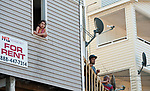 WATERBURY,  CT-051817JS04- Neighbors look on as police and fire investigators were on the scene Thursday the day after a fire destroyed four homes on Lounsbury Street  in Waterbury on Thursday <br /> Jim Shannon Republican-American