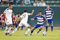 CARSON, CA – August 6, 2011: FC Dallas midfielder Bruno Guarda (8) during the match between LA Galaxy and FC Dallas at the Home Depot Center in Carson, California. Final score LA Galaxy 3, FC Dallas 1.