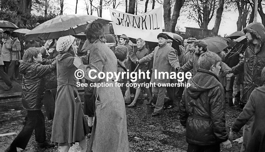 Peace People March along the Falls Road, Belfast, N Ireland, UK, 23rd October 1976 - Peace marchers join hands as they are confronted by Sinn Fein opponents. 197610230506w<br />