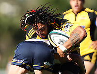 Ma'a Nonu crashes into a tackle during the Super 14 rugby union match between the Hurricanes and Brumbies at Porirua Park, Wellington, New Zealand on Friday 29 January 2010. Photo: Dave Lintott / lintottphoto.co.nz
