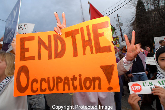 ATLANTA, GA - JAN 5, 2009: Deafening chants of &quot;Long Live Palestine!&quot; could be heard during rush hour outside the Midtown building that houses the Israeli consulate. <br />