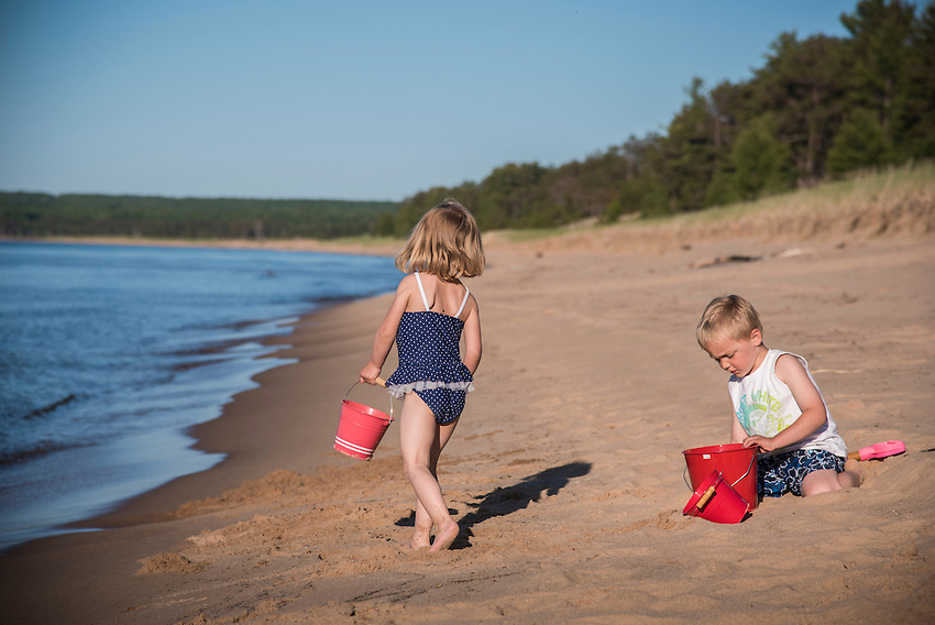Children play on a Lake Superior beach.