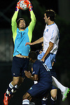 06 October 2015: UNCW's Sean Melvin (CAN) (1) grabs the ball under pressure from North Carolina's Tucker Hume (right). The University of North Carolina Tar Heels hosted the University of North Carolina Wilmington Seahawks at Fetzer Field in Chapel Hill, NC in a 2015 NCAA Division I Men's Soccer match. North Carolina won the game 3-0.