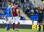 St Johnstone v Hearts...25.09.11   SPL Week 9.Andy Webster booked by Stevie O'Reilly.Picture by Graeme Hart..Copyright Perthshire Picture Agency.Tel: 01738 623350  Mobile: 07990 594431