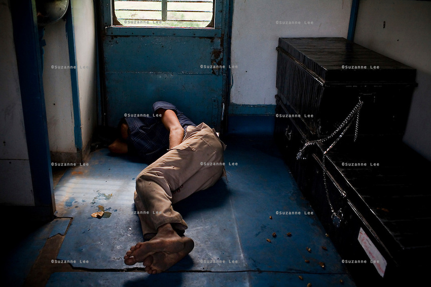 A beggar man sleeps on the floor at the door of the sleeper coach on the Himsagar Express 6318 as it passes from Maharashtra to Andhra Pradesh on 8th July 2009.. .6318 / Himsagar Express, India's longest single train journey, spanning 3720 kms, going from the mountains (Hima) to the seas (Sagar), from Jammu and Kashmir state of the Indian Himalayas to Kanyakumari, which is the southern most tip of India...Photo by Suzanne Lee / for The National