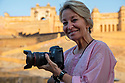 India, Jaipur, Historical City, photographer Jami Tarris in front of Jaipur Fort