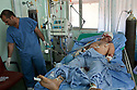 A wounded Iraqi man is treated at the Khadamiyah hospital following a car bomb blast in North Baghdad August 25, 2010. The man succombed to his injuries just minutes after this picture was taken. A series of coordinated bomb attacks targeting Iraqi security forces killed more than 50 people today across the country, a mere day after U.S. troop levels deployed to Iraq fell below 50,000.   .