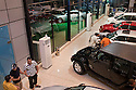 Iraqis check out the latest models of imported American cars at a recently opened Dodge/Jeep/Chrysler dealership in the Karrada district of Baghdad August 23, 2010. Iraqis have developed a healthy appetite for newly available consumer goods including cars, satellite dishes and cel phones over the past several years.  .