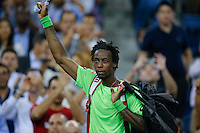 Gael Monfils of France leaves the court after losing against Roger Federer of Switzerland during their quarter-final game at the US Open 2014 tennis tournament at the USTA Billie Jean King National Center in New York.  09.04.2014. VIEWpress