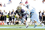 23 April 2016: Notre Dame's P.J. Finley (31) and North Carolina's Stephen Kelly (24) challenge for a draw. The University of North Carolina Tar Heels hosted the University of Notre Dame Fighting Irish at Kenan Stadium in Chapel Hill, North Carolina in a 2016 NCAA Division I Men's Lacrosse match. UNC won the game 17-15.