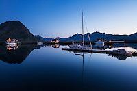 Sailboat mooring at twilight in the harbor at Ramberg, Flakstadøy, Lofoten Islands, Norway