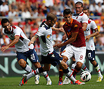 Calcio, Serie A: Roma vs Bologna. Roma, stadio Olimpico, 16 settembre 2012..AS Roma forward Erik Lamela, of Argentina, second from right, is chased by Bologna players during the Italian Serie A football match between AS Roma and Bologna at Rome's Olympic stadium, 16 september 2012..UPDATE IMAGES PRESS/Isabella Bonotto