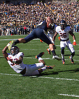 Virginia safety Kelvin Rainey (38) makes a tackle. The Pitt Panthers football team defeated the Virginia Cavaliers 26-19 on Saturday October 10, 2015 at Heinz Field, Pittsburgh, Pennsylvania.