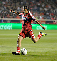 Chicago Fire midfielder Sebastian Grazzini (10) shoots the ball.  The Chicago Fire defeated the Philadelphia Union 1-0 at Toyota Park in Bridgeview, IL on March 24, 2012.