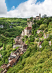 The castle and village of Rocamadour, as viewed from the road to the castle. Rocamadour is a pilgrimage site and is the second most visited site in France.