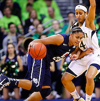 SOUTH BEND, IN - MARCH 04: Kaleena Mosqueda-Lewis #23 of the Connecticut Huskies dribbles against Skylar Diggins #4 of the Notre Dame Fighting Irish at Purcel Pavilion on March 4, 2013 in South Bend, Indiana. Notre Dame defeated Connecticut 96-87 in triple overtime to win the Big East regular season title. (Photo by Michael Hickey/Getty Images) *** Local Caption *** Kaleena Mosqueda-Lewis; Skylar Diggins