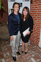 LOS ANGELES, CA, USA - OCTOBER 21: Lawrence Bender, Robin Bronk arrive at The Creative Coalition's 'Art of Discovery' Los Angeles Launch Party held at the Home of Lawrence Bender on October 21, 2014 in Los Angeles, California, United States. (Photo by David Acosta/Celebrity Monitor)