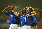 Partick v Rangers 22.12.02: Amoruso and team-mates mob Ronald de Boer after the winning goal
