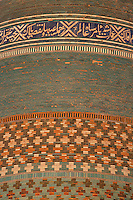 Detail of glazed brick in decorative bands, Kalta Minor Khiva, Uzbekistan, pictured on July 5, 2010, in the afternoon. The Kalta Minor or Short Minaret was commissioned by Mohammed Amin Khan in 1852 to stand 70 m. high, but was abandoned when he died in 1855, and remains only 26 m. high. Khiva, ancient and remote, is the most intact Silk Road city. Ichan Kala, its old town, was the first site in Uzbekistan to become a World Heritage Site(1991). Picture by Manuel Cohen.